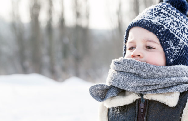 Little boy portrait in winter. Happy child face close-up.