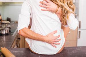 Couple having sex on kitchen counter