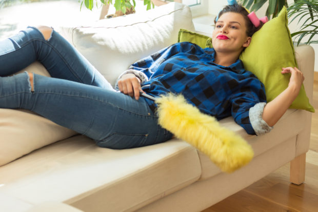 Perfect trendy housewife is relaxing on couch