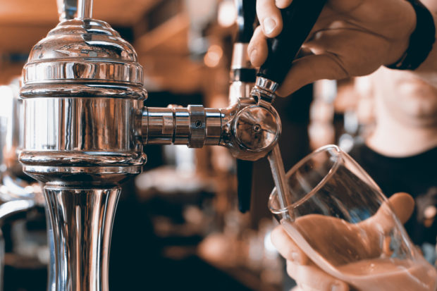 Chrome beer taps with highlights in the pub